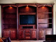 Custom Made Built In Entertainment Center - recessed lighting; slight changes to area below television
