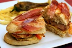 "There are so many typical foods in Seville that are worth trying, and the best bit is that they all come in small ""tapa"" size portions. These little sandwiches are called serranito de cerdo."