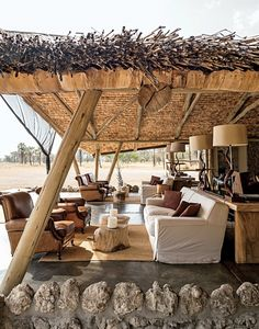 Unlike the permanent-feeling structures at the lodge, which are built on concrete foundations, the five tents at Little Chem Chem, a 45-minute drive away, speak a more traditional safari vernacular of sisal, wicker, and leather. Pale greens and taupes nod to the surrounding savanna.