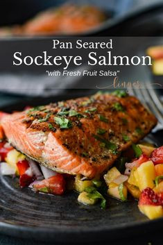Pan Seared Sockeye Salmon with Fruit Salsa dish is healthy quick and easy The salmon is marinated in a lemon-lime garlic sauce pan seared in a cast iron pan and rests on a colorful bed of fresh fruit salsa sockeyesalmon seafood Healthy Salmon Recipes, Fish Recipes, Seafood Recipes, Vegetarian Recipes, Cooking Recipes, Sockeye Salmon Recipe Pan, Pan Seared Salmon, Fruit Salsa, Fish Dishes