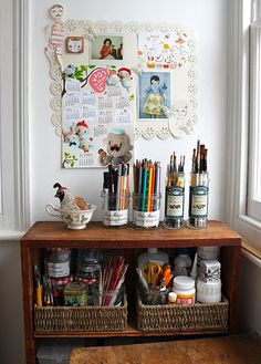 Yep. This is the way we try to keep our homeschool. Pencils, markers, brushes in jars. Baskets for the overflowing bits. Why doesn't mine stay so neat & nice as this, though? Oh. We added the turtle in the window. He takes up a lot of space!