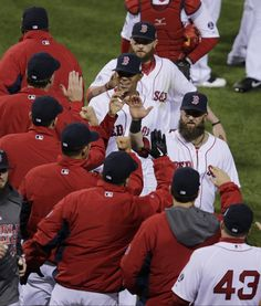 #WorldSeries2013 #Bosox #SLCardinals Boston Red Sox players celebrate after Game 1 of baseball's World Series against the St. Louis Cardinals Wednesday, Oct. 23, 2013, in Boston. The Red Sox won 8-1 to take a 1-0 lead in the series. (AP Photo/Charles Krupa)