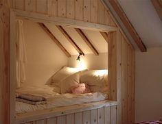 A wood paneled bed alcove at the Manor House Stables in Lincolnshire via Elite Cottages