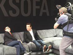 #rickmercer and #tommysmythe share an inside joke on an outsize sofa at #ids18 Montauk Sofa booth. #montauksofa #livelarge #interiordesign