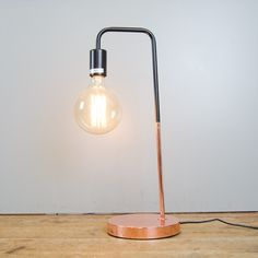 Stunning copper and black lamp with a weighted base. Sold with a large filiament bulb included. Ideal for a desk, bedside or living room.