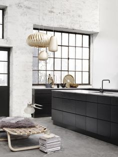 Tom Rossau pendants in this black and white kitchen http://www.nest.co.uk/browse/brand/tom-rossau Via Vosgesparis.