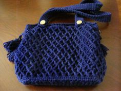 Crocheted purse.  Here is the trellis stitch in navy blue, this time without the bobble in the center of the diamond shapes.  Goes a little faster that way!  Fully lined, magnetic clasps, straps are fastened with decorative buttons.