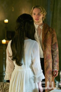 "Reign -- ""Forbidden"" -- Image Number: RE215a_0456.jpg -- Pictured (L-R): Adelaide Kane as Mary, Queen of Scotland and France (back to camera) and Toby Regbo as King Francis II -- Photo: Sven Frenzel/The CW -- © 2015 The CW Network, LLC. All rights reserved.pn"