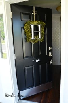 Curb Appeal via @Amy Lyons Lyons Lyons Huntley (The Idea Room): painted black door #lowescreator