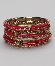 This Gold & Fuchsia Twist Bangle Set is perfect! #zulilyfinds.........Fuschsia, Awesome! A must have!!