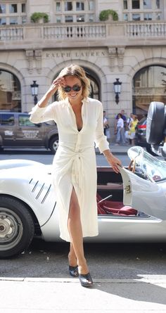 Stepping out in style: Kelly Framel (@theglamourai) makes an entrance in a Ralph Lauren Collection white dress and chic, black frames from the automotive eyewear collection.