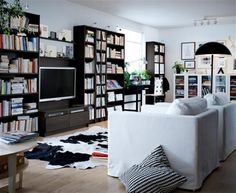 Adorable IKEA Living Room Design Ideas : Amazing White Painted Wall IKEA Living Room with Open Large Bookshelf and White Sofa