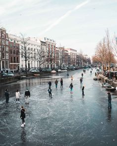 Ice skaters on the frozen canals in Amsterdam The Netherlands Netherlands Holland Travel Destinations Netherlands Honeymoon Backpack Netherlands Backpacking Netherlands Vacation Netherlands Photography Europe Budget Bucket List Wanderlust Amsterdam Canals, Amsterdam City, Amsterdam Travel, Amsterdam Netherlands, The Netherlands, Amsterdam Winter, Visit Amsterdam, Places To Travel, Travel Destinations