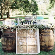 This outdoor whisky barrel bar is kind of everything. Photo by @cassidycarsonphoto, Planning and Coordination @shannon.reeves | Floral Design @missygunnels | Rentals @terriannsmith, Featured on @southernweddings  #charming #summer #wedding