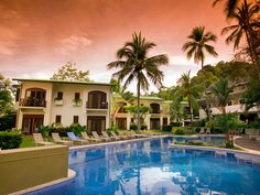 The Hotel Club Del Mar is situated on the oceanfront in a quiet cove at the south end of Jaco Beach, surrounded by mature tropical gardens, towering trees and palms.