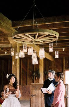 wagon wheels, barn wedding lighting, barn wedding lights, barn weddings, mason jars, wagon wheel wedding