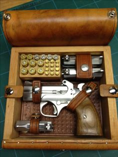 Bond Arms derringer box and accessories... By: the Uker of OZ