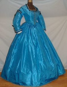 An electric blue Civil War era silk day dress. The color of this dress is truly extraordinary, and seems to have been quite popular in the mid to late 1860s