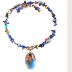 """Lapis/Glass Bead/Semi-Precious Stone Necklace This is an 18"""" coil wire necklace made of lapis and other semi-precious stones as well as glass beads. Glass pendant is 925 stamped with a garnet center stone. Jewelry Necklaces"""