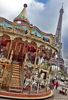 How we pass many Sunday afternoons..... at the carousel at the Eiffel Tower....  www.carinaokula.com