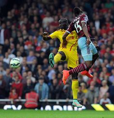 Mamadou Sakho of Liverpool goes up with Diafra Sakho of West Ham United during the Barclays Premier League match between West Ham United and Liverpool at Boleyn Ground on September 20, 2014 in London, England. (Photo by John Powell/Liverpool FC via Getty Images)