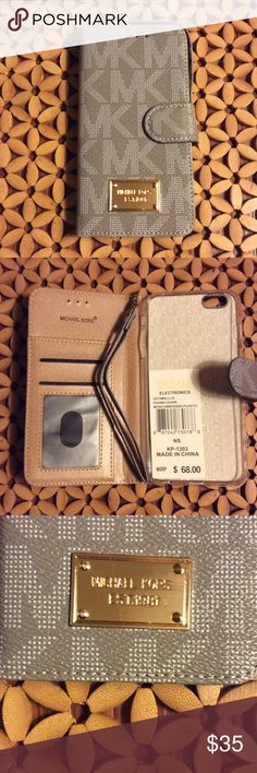 MK iPhone 6s Plus wallet case Michael kors iPhone 6 Plus and 6s Plus Wallet  case. Start your day in style. Easy to access to all bottoms. White / gray color. New with box and tag. Michael Kors Accessories