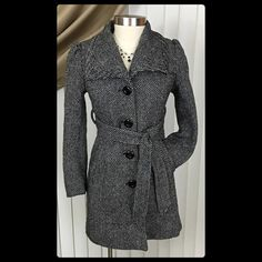 """❄️Guess Petite Small Belted Wool Trench Pea Coat Guess PETITE SMALL Wool Trench Coat. This coat is way too cute to be left in my closet! Speckled black and white (almost herringbone) print throughout. Deep pockets at the hip, ties high at the waist for a figure flattering hourglass shape, slight puff at the shoulders, and a rear slit to allow movement. This coat is in excellent pre-owned condition. Very few thread pulls. Make me an offer! Bust: 20"""" flat. Shoulder: 14"""". Underarm to cuff: 17""""…"""