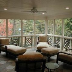 Interior view of screened-in outdoor room.  Canned lighting, ceiling fan, decorative rails, low maintenance flooring and comfortable furnishings create comfort and style.