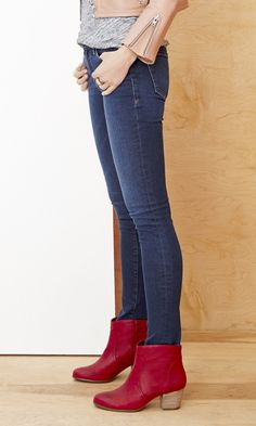 Pop of red: versatile leather ankle bootie with a rounded toe and walkable stacked heel