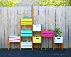 What do you do when you have a small yard and chickens that eat all the plants they can find? You build yourself a vertical rainbow garden! I'm sure a couple of… Cedar Planter Box, Wooden Planters, Planter Boxes, Jardin Vertical Diy, Vertical Garden Diy, Wooden Crate Vertical Garden, Vertical Gardens, Hanging File Organizer, Home And Garden Store