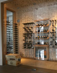 Decorating. Stunning Ideas Of Wine Room Decorations. Glamorous Wine Room Decorations Featuring Concrete Wall And Wall Mounted Wine Bottle Metal Hooks And Glass Wall Dividers Along With Glass Wine Room Door As Well As Stainless Steel Handles