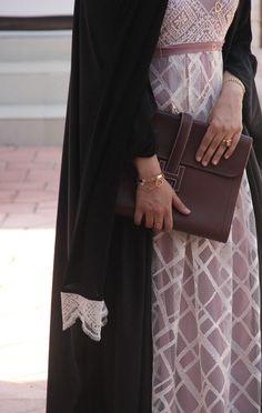 handbag and abaya