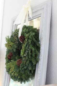 wreath hanging above mirror