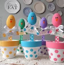 DIY: painted flower pot, plastic spoons, ribbon. Cute for a baby shower, kids party  TimelessTreasure.theaspenshops