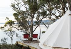 Once the humble holiday spot of a reclusive poet and writer, Tasmania's impossibly beautiful Satellite Island is now a dreamy coastal-luxe sanctuary that – for a few… The Doors, Ends Of The Earth, Australia Travel, Bait, Glamping, Outdoor Gear, Adventure Travel, Seaside, Melbourne