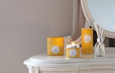Shearer Candles Amber and Rose Candles. A strong floral scent of tuberose with top notes of violet and amber. Available as jar candles, tin candles, pillar candles, tealights, in candle gift boxes, as, scented reed diffusers, diffuser refills and pillar jar candles. Beautiful yellow packaging.
