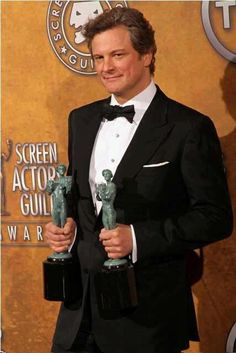 2011 SCREEN ACTORS GUILD (SAG) AWARDS ~ Colin Firth wins Best Actor for THE KING'S SPEECH (2010), and the film wins Outstanding Performance by a Cast in a Motion Picture.