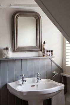 painted wood paneling and mirror, new fixtures and it's as good as new