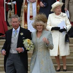 """The Prince of Wales leaving St George's Chapel in Windsor after marrying Camilla Parker-Bowles, making her an HRH and the Duchess of Cornwall. Queen Elizabeth II attended their religious blessing but was not present at their civil ceremony. The monarch told guests in a speech at the wedding reception that her son was """"home and dry with the woman he loves""""."""