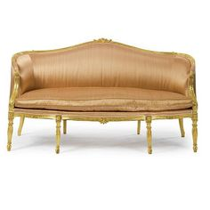 A George III giltwood sofa in a manner of Francois Hervé c