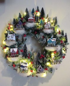 This is truly a very unique Christmas wreath that you can do because you can find more than leaves and flowers on it, but an entire miniature village. Christmas village wreath Once again it's Christmas! It's… Continue R Noel Christmas, Winter Christmas, Christmas Ornaments, Pallet Christmas, Family Christmas, Christmas Village Display, Christmas Villages, Christmas Houses, Diy Christmas Village Accessories
