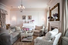 Classic cushy slipcovered furniture, twinkly chandeliers, and an imperfect carved gold mirror give balance to Jessica's inviting but traditional living room. www.shabbychic.com