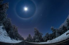 A QUADRUPLE  LUNAR  HALO  OVER  SPAIN  Sometimes falling ice crystals make the atmosphere into a giant lens causing arcs and halos to appear around the Sun or Moon.     Madrid, Spain, where a winter sky displayed not only a bright Moon but as many as four rare lunar halos. The brightest object, near the top of the above image, is the Moon. Light from the Moon refracts through tumbling hexagonal ice crystals into a 22 degree halo seen surrounding the Moon.  Image Credit & Copyright: Dani…