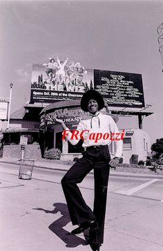 """8 X 10 promotional photo of 19 year old Michael Jackson. This photo was taken in front of a large advertising billboard to promote his 1978 film """"The Wiz"""" The photo is new and was made from the vintage negative that came out of the Photoplay Magazine Archives."""