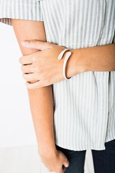 Keep your look sleek and chic with this sculptural, silvertone double-ended bangle bracelet.