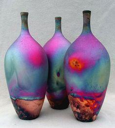 Hand thrown raku fired fumed copper matt bottles by Chris Hawkins