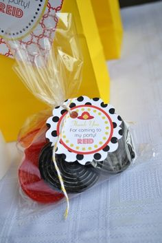 Cute and simple favor: Red and black licorice in rolls looks like fire hose or wheels for train, truck, fire truck, transportation birthday themes