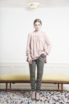 Rützou nude blouse with high neck and grey trousers