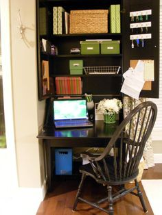 Dream desk! Stylish binders to hold important papers, boxes for greeting and thank you cards with envelopes and stamps, wicker baskets for scrapbooking materials, hooks for spare keys, pencil holder, and vibrant (fake) flowers.