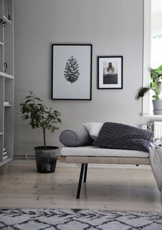 Scandinavian living room with black & white photos & IKEA bookshelf hack